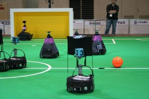 A RoboCup game in the middle-size league (Osaka, 2006). FU-Fighters in blue.