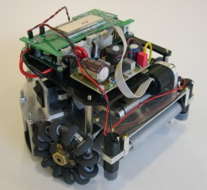 FU-Fighters small-size robot (2003). The on-board-processor is visible, as well as the omnidirectional wheels.